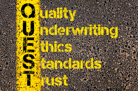 Concept image of Accounting Business Acronym QUEST Quality, Underwriting, Ethics, Standards, and Trust written over road marking yellow paint line. Stock Photo