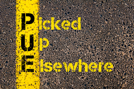 marking up: Concept image of Accounting Business Acronym PUE Picked Up Elsewhere written over road marking yellow paint line.