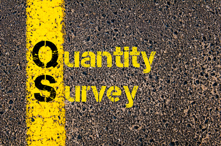 qs: Concept image of Accounting Business Acronym QS Quantity Survey written over road marking yellow paint line. Stock Photo
