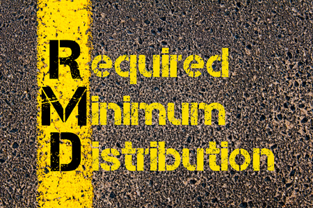 Concept image of Accounting Business Acronym RMD Required Minimum Distribution written over road marking yellow paint line. Banco de Imagens