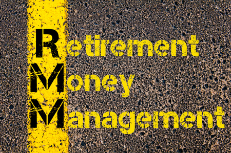 Concept image of Accounting Business Acronym RMM Retirement Money Management written over road marking yellow paint line.