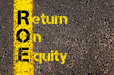 equity: Concept image of Accounting Business Acronym ROE Return On Equity written over road marking yellow paint line.