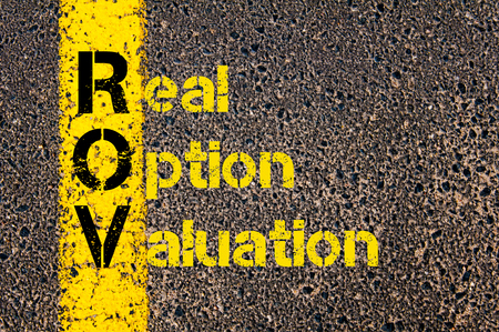 valuation: Concept image of Accounting Business Acronym ROV Real Option Valuation written over road marking yellow paint line.
