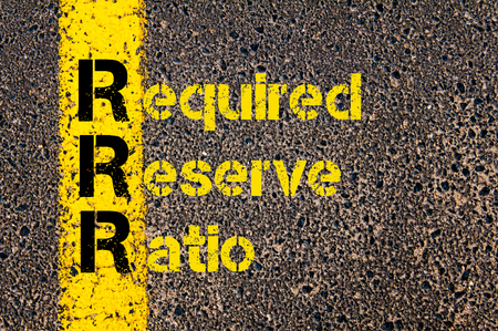 required: Concept image of Accounting Business Acronym RRR Required Reserve Ratio written over road marking yellow paint line.