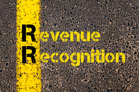 Concept image of Accounting Business Acronym RR Revenue Recognition written over road marking yellow paint line.