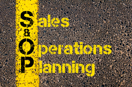 sop: Concept image of Accounting Business Acronym S&OP Sales and Operations Planning written over road marking yellow paint line.