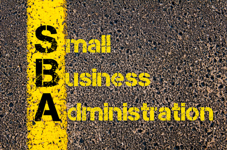 Concept image of Accounting Business Acronym SBA Small Business Administration written over road marking yellow paint line. Фото со стока