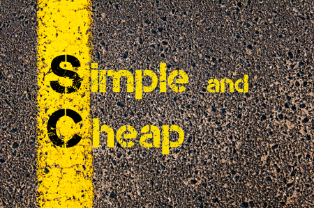 sc: Concept image of Accounting Business Acronym SC Simple and Cheap written over road marking yellow paint line. Stock Photo