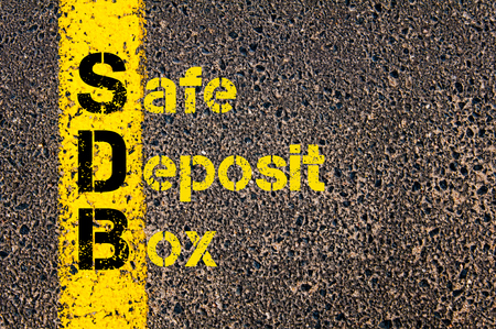 safe deposit box: Concept image of Accounting Business Acronym SDB Safe Deposit Box written over road marking yellow paint line.