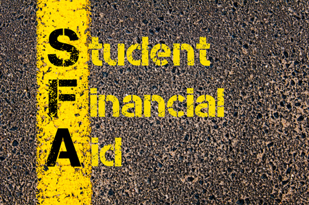 financial aid: Concept image of Accounting Business Acronym SFA Student Financial Aid written over road marking yellow paint line.