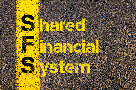 shared: Concept image of Accounting Business Acronym SFS Shared Financial System written over road marking yellow paint line.