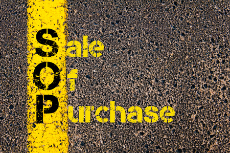 sop: Concept image of Accounting Business Acronym SOP Sale Of Purchase written over road marking yellow paint line. Stock Photo