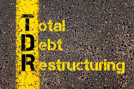 restructuring: Concept image of Accounting Business Acronym TDR Total Debt Restructuring written over road marking yellow paint line.