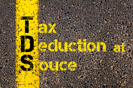 deduction: Concept image of Accounting Business Acronym TDS Tax Deduction at Source written over road marking yellow paint line. Stock Photo