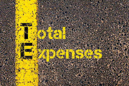 te: Concept image of Accounting Business Acronym TE Total Expenses written over road marking yellow paint line.