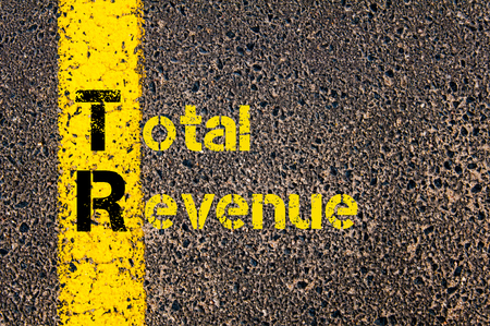 tr: Concept image of Accounting Business Acronym TR Total Revenue written over road marking yellow paint line.