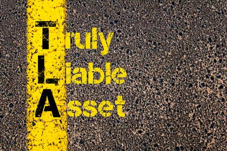 truly: Concept image of Accounting Business Acronym TLA Truly Liable Asset written over road marking yellow paint line.