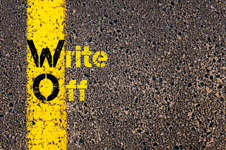 write off: Concept image of Accounting Business Acronym WO Write Off written over road marking yellow paint line.
