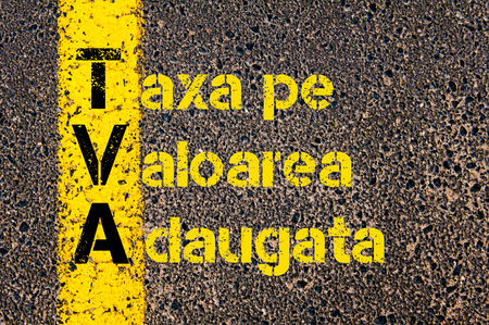 Concept image of Accounting Business Acronym TVA Taxa Pe Valoarea Adaugata ( Value Added Tax in Romanian ) written over road marking yellow paint line. Banco de Imagens
