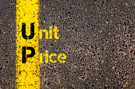 marking up: Concept image of Accounting Business Acronym UP Unit Price written over road marking yellow paint line.