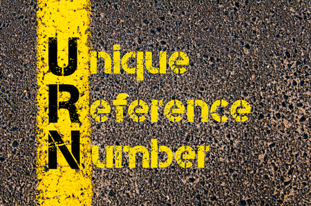 urn: Concept image of Accounting Business Acronym URN Unique Reference Number written over road marking yellow paint line.