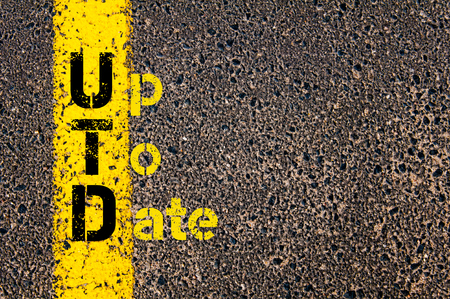 marking up: Concept image of Accounting Business Acronym UTD Up To Date written over road marking yellow paint line.