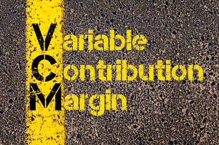 variable: Concept image of Accounting Business Acronym VCM Variable Contribution Margin written over road marking yellow paint line. Stock Photo