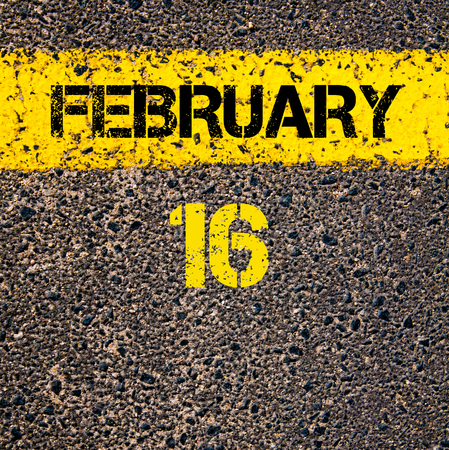 road marking: 16 February calendar day written over road marking yellow paint line