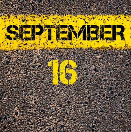 road marking: 16 September calendar day written over road marking yellow paint line
