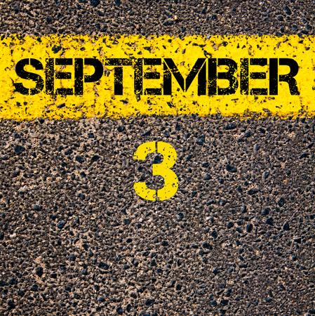 road marking: 3 September calendar day written over road marking yellow paint line