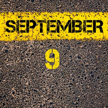 september 9th: 9 September calendar day written over road marking yellow paint line