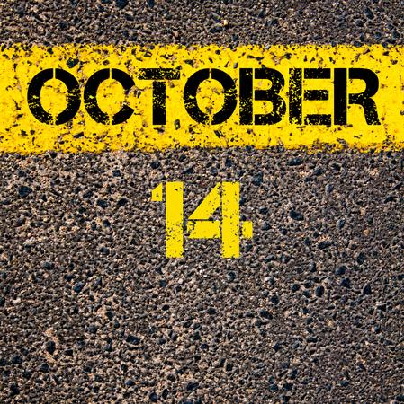 october calendar: 14 October calendar day written over road marking yellow paint line