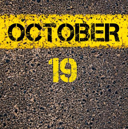 october calendar: 19 October calendar day written over road marking yellow paint line