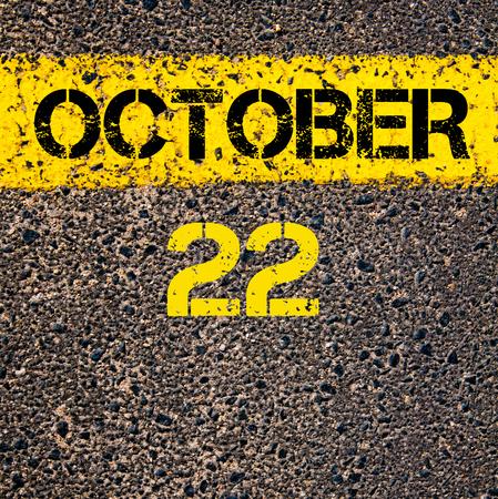 october calendar: 22 October calendar day written over road marking yellow paint line