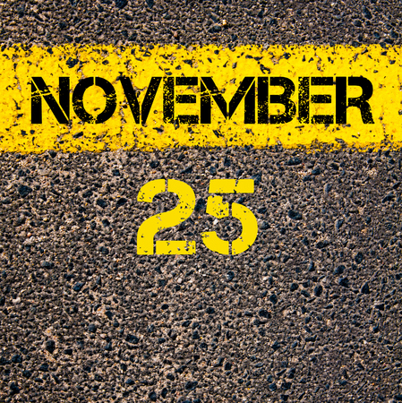 november calendar: 25 November calendar day written over road marking yellow paint line