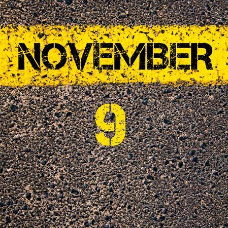 november calendar: 9 November calendar day written over road marking yellow paint line