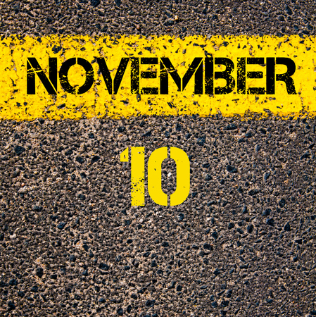 november calendar: 10 November calendar day written over road marking yellow paint line