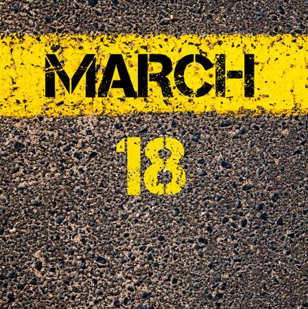 calendar date: 18 March calendar day written over road marking yellow paint line