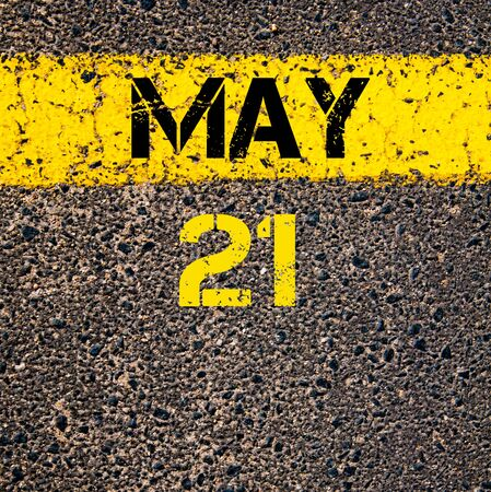 road marking: 21 May calendar day written over road marking yellow paint line