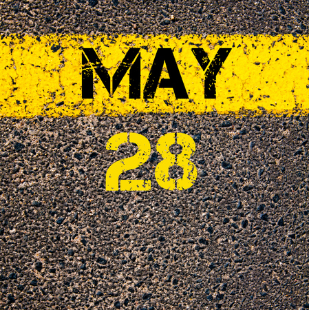 28: 28 May calendar day written over road marking yellow paint line