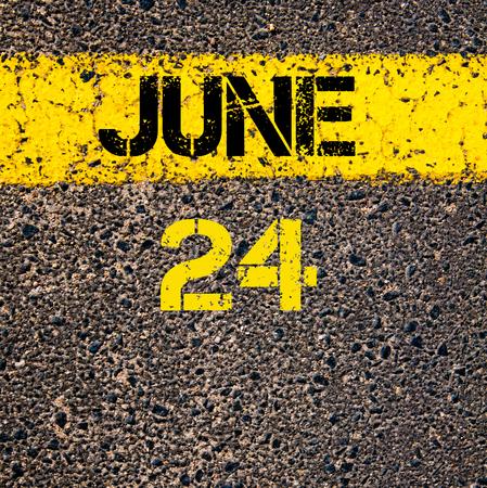 june: 24 June calendar day written over road marking yellow paint line Stock Photo