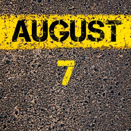 road marking: 7 August calendar day written over road marking yellow paint line