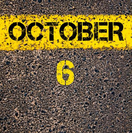 october calendar: 6 October calendar day written over road marking yellow paint line