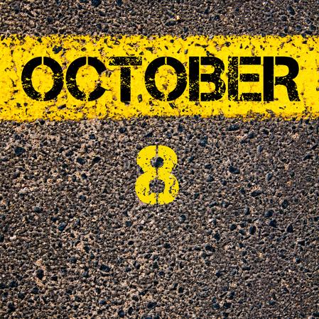 october calendar: 8 día de octubre del calendario escrito sobre marcado la línea de pintura de color amarillo carretera Foto de archivo