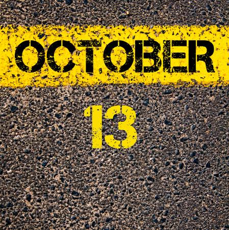 october calendar: 13 de día de octubre del calendario escrito sobre marcado la línea de pintura de color amarillo carretera Foto de archivo