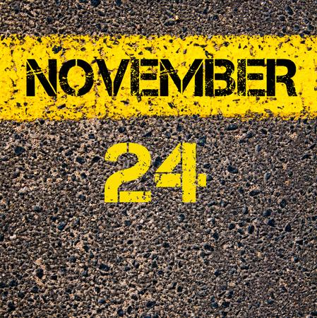november calendar: 24 November calendar day written over road marking yellow paint line