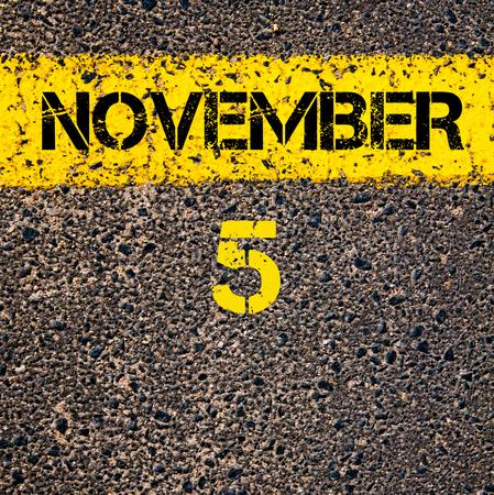 calendario noviembre: 5 November calendar day written over road marking yellow paint line