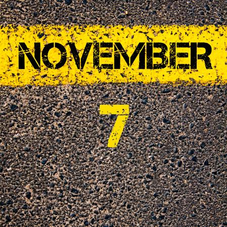calendario noviembre: 7 November calendar day written over road marking yellow paint line