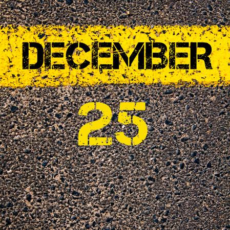 december 25th: 25 December calendar day written over road marking yellow paint line Stock Photo