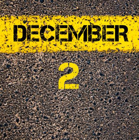 road marking: 2 December calendar day written over road marking yellow paint line